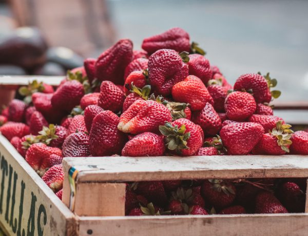 Crate of strawberries piled high